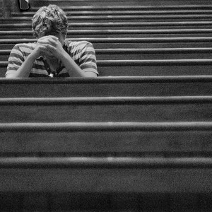 teen boy praying